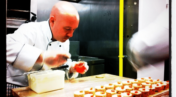 Chef preparing canapes on opening night Copan.